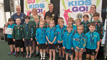 1st North Worle Scouts receiving their cheque from Lion Malcolm Timis and MC Tim Lamb at Weston Lion