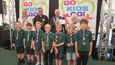1st Ashcombe Cubs receiving their cheque from Mayor Cllr Mark Canniford and MC Tim Lamb at Weston Li