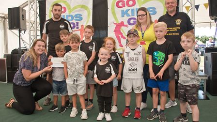 Boxer Tots receiving their cheque from Ellie Young and MC Tim Lamb at Weston Lions Club Go Kids Go!