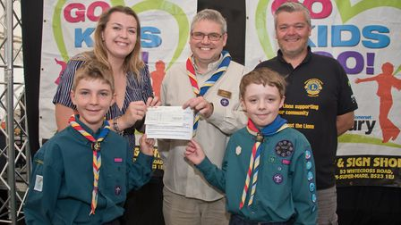 Ashcombe Scouts receiving their cheque from Ellie Young and MC Tim Lamb at Weston Lions Club Go Kids