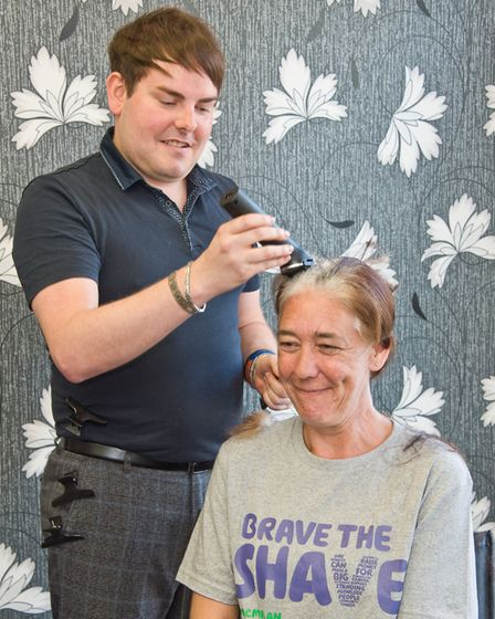 Jane Wood having her head shaved for Macmillan cancer support, at Bright Hair, Waterloo Street, West
