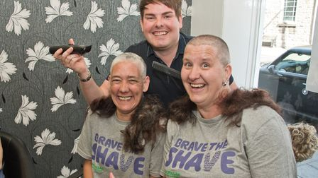 Karl Bright with Clare Burrell and Jane Wood, who had their heads shaved for Macmillan. Picture: MAR