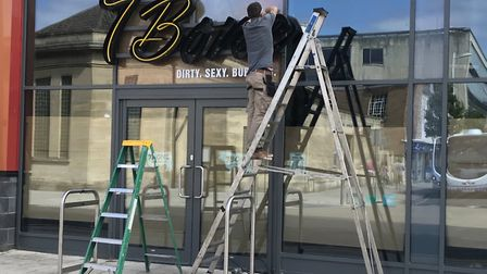 7Bone Burger Co's signs were removed on Monday.
