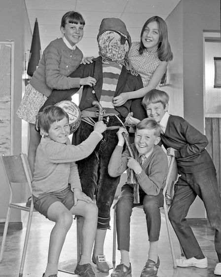 """Pupils of Windwhistle Primary School with the life-sized dummy shop """"model"""" acquired by the school."""