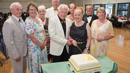 Mike and Vera Bancroft with committee members cutting the cake at the Cheddar Old Tyme and Modern Se