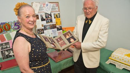 Mike and Vera Bancroft, with some of the memorabilia from 50 years of the Cheddar Old Tyme and Moder
