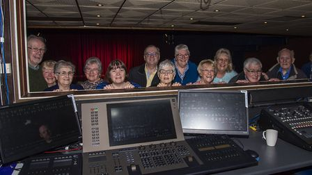 Friends of the Playhouse members with the lighting board. Neil Gibson