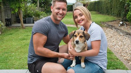 Jessica and Richard Lloyd with their new dog Bluebell which they adopted when they found her on a be