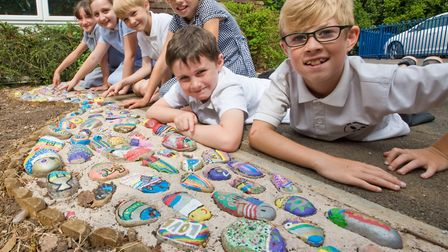 Pupils of Grove Junior School decorated pebbles and have added them to a path to celebrate their uni