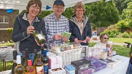 Julie and Robert Manley, Ann Long and Nora Broomfield on the raffle stall. Picture: MARK ATHERTON
