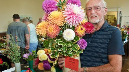 Graham Mizen with an armful of his prize winning blooms at Yatton and District Horticultural Society