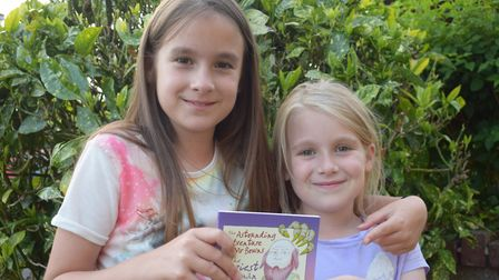 Willow and Phoebe after beating the witch and winning their book.