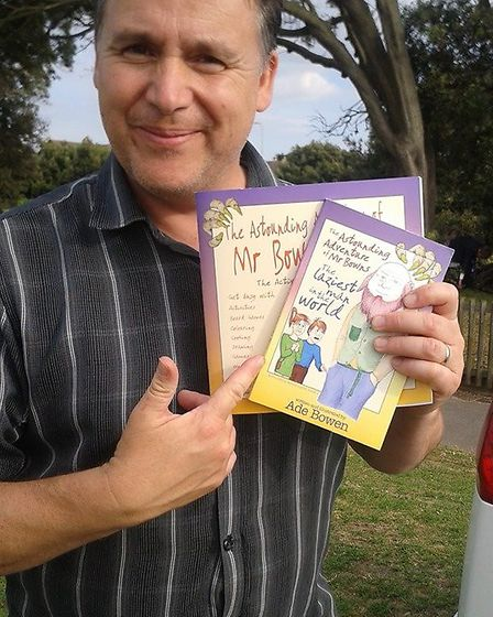 Ade with a copy of his new children's book.