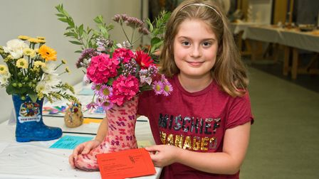 Kathryn Morgan won a first for her flower arrangement in a wellington boot. Picture: MARK ATHER