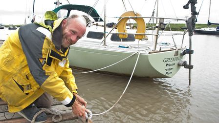 Andy Press on his sailing boat, Greenfingers. Picture: MARK ATHERTON