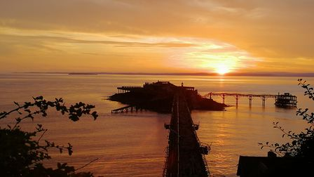The sunset creates a silhouette of Westons Birnbeck Pier.Picture: Helen Kempton