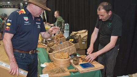 Liam Fitzpatrick from the No Meat Steak Company serving a customer at Weston Vegan Fair. Picture: