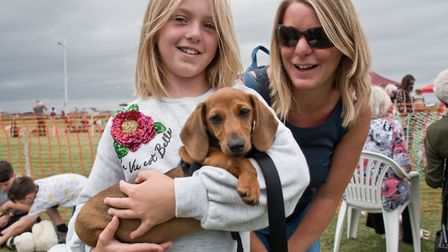 Frankie and Jo with puppy Ziggy at Weston RSPCA dog show. Picture: MARK ATHERTON