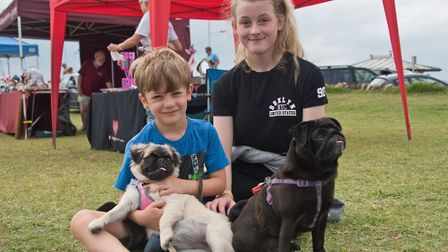 Isaac and Kitty with pugs Margo and Patsey at Weston RSPCA dog show. Picture: MARK ATHERTON