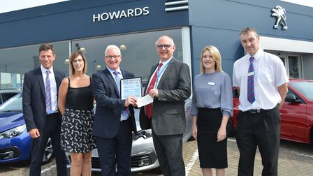 Peter Haynes of event sponsor Howards Motor Group is joined by some of the firm's Mendip Challenge t