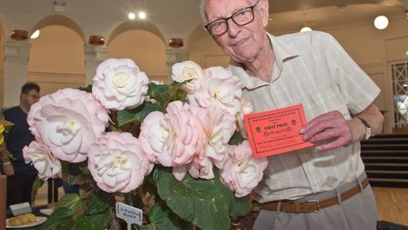 Bert Filer with his prize winning Begonia at Weston-super-Mare Horticultural Society Flower Show.
