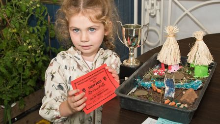 Olivia Zeigler with a first for her miniature garden. Weston-super-Mare Horticultural Society Flower