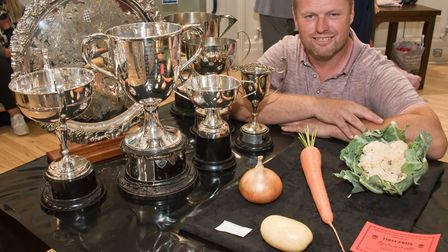 Steven Ellis with a collection of trophies at Weston-super-Mare Horticultural Society Flower Show.