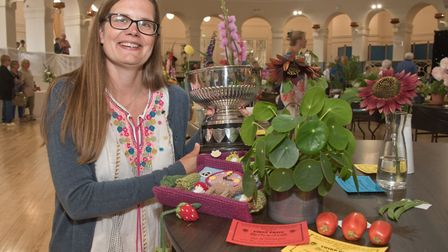 Victoria Pratt with a trophy and a collection of her exhibits. Weston-super-Mare Horticultural Socie