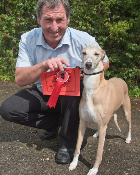 Winner of the open class entry Andy Tottle with his Whippet Kell. Picture: MARK ATHERTON
