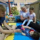 Volunteers Jackie and Chris with a children at Springboard Oppportunity Group.
