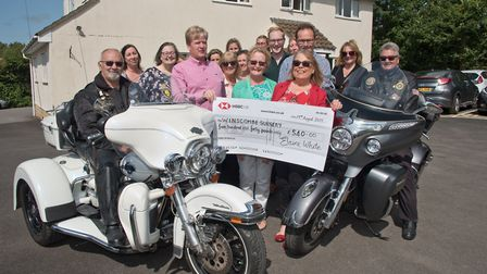 Elaine White with members of her choir and bikers Peter Emery and Frank Bamford presenting £540 to D