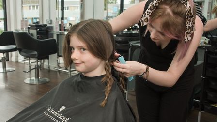 Max Penney having his hair cut, for the Little Princess Trust charity, at the Broad St. Hair Salon i