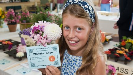 Mia Hosford wins a first for her flowers at Wrington annual show. Picture: MARK ATHERTON
