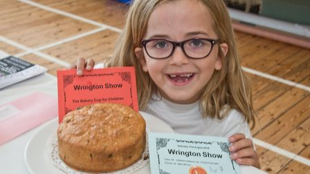 Mary Murray won the Children's Bakery Cup for her fruit cake at Wrington annual show. Picture: MA