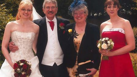 Beverley and Pete Merchant, with daughters Gemma and Kelly.
