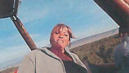 Natalie Davis in a hot air balloon in Africa in 2013. Picture: DWP