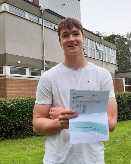 George Taylor celebrating his results at Backwell School.