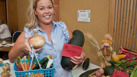 Zoe Barlett with prizes for her vegetables at Kingston Seymour Village Show. Picture: MARK ATHERT