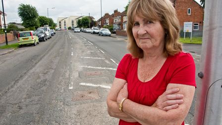 Joan Price raising a petition about the state of Baytree Road in Milton. Picture: MARK ATHERTON
