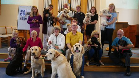 Members of the Methodist congregation with their pets.