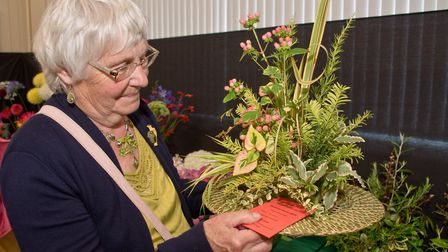 Ros Mizen with one of her prize winning exhibits in the floral art classes. Sandford Gardening Club