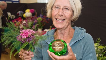 Jenny Nicholas with a prize for her flower arrangement in a wine glass. Sandford Gardening Club Summ