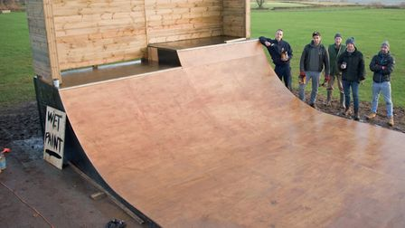 Sk8 or Die volunteers completing the new skate ramp they have built at Merlin Park. Picture: MARK