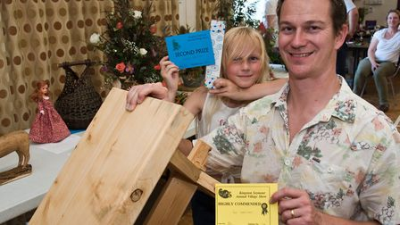 Ian Wariner won a highly commended for his wooden bench and daughter Briony won a prize for her book