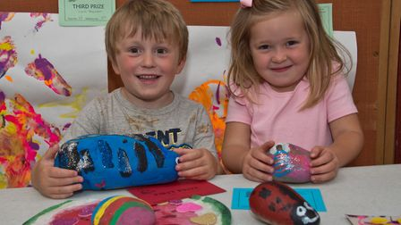 Seb Simmons and Winnie Maker with their decorated pebbles at Kingston Seymour Village Show. Pictu