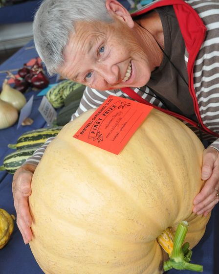 Hilary Bibb with her giant pumpkin which they decided not to weigh as it would have broken the scale