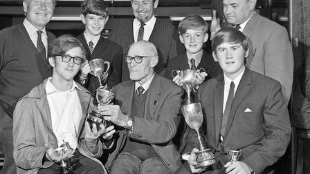 Mr. Billy Wells (vice-president, Weston Angling Association) presents trophies won by juniors at a U