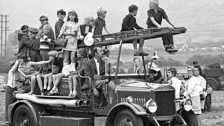 Children get a ride on a 1928 Dennis fire engine owned by Messrs. Holder, of Congresbury at the a tr