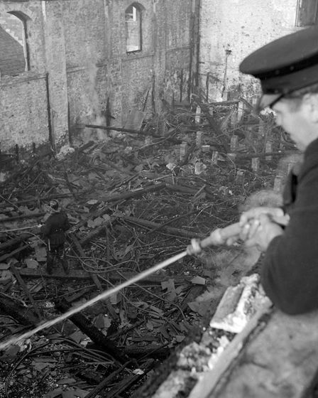 Weston Playhouse destroyed in night fire drama. A fireman directs a branch at the still smouldering
