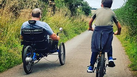 Dave and his son testing the trike he is raising money for